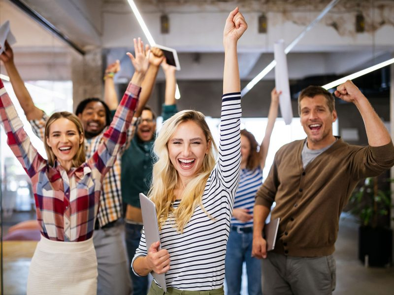 happy-business-people-celebrating-success-at-compa-SXQJZNS.jpg